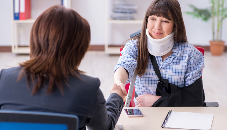 A young injured lady worker meeting with our worker compensation attorney at Find Your Lawyer 911