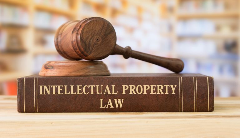 An intellectual property law book with A Gavel at our library at Find Your Lawyer 911