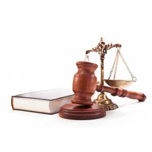 A gavel, law scale and a book at Law Offices Of Daniel Santiago Clifton NJ
