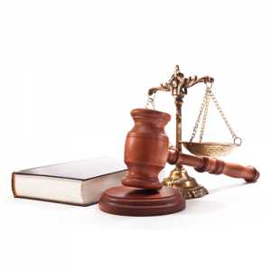 A law scale along with a book and a gavel