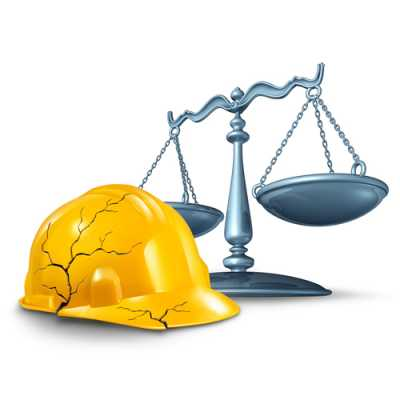 A law scale along with a broken worker's helmet