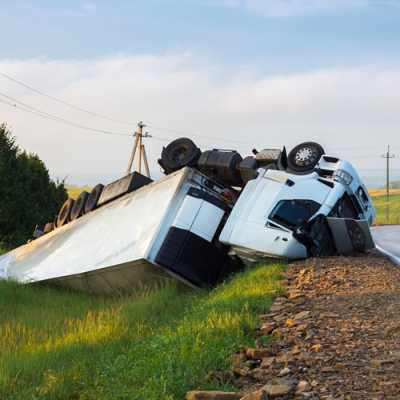 A truck met an accident along with the rodeside and felt vertically downward