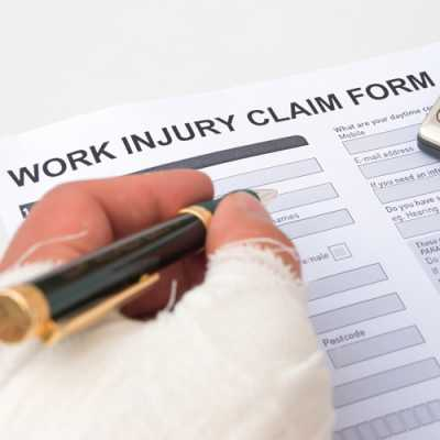 An injured worker filling the form of 'worker injury claim' at Michael D. Russo Woodland Park NJ