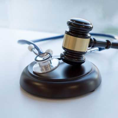 Doctors' Stethoscope along with A gavel at a table in Calcagno And Associates Westfield NJ