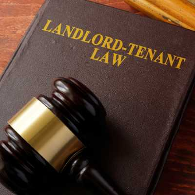 Landlord and tenant law book along with a gavel on a table at Michael D. Russo Woodland Park NJ