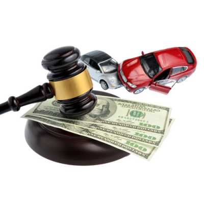 Models of two cars hitting each other while a gavel is also present along with few banknotes