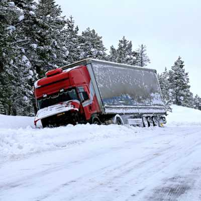 Picture of A truck slipped and felt from the road due to heavy snowfall
