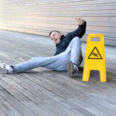 a man feeling pain just felt down due after slipping on the floor.