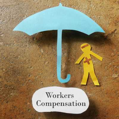 demonstration of an umbrella and a sick worker at a board and workers' compensation written at the bottom