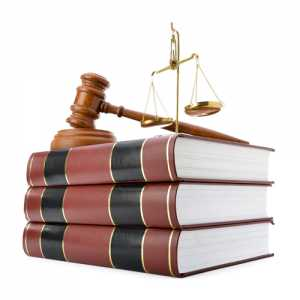 law scale and a gavel on Law books at Jaloudi & Associates Clifton NJ