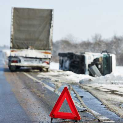 two trucks met an accident along with the roadside after the snowfall